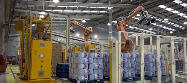Robots stacking paper rolls at SCA in UK