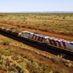 Rio Tinto locomotives and wagons operating in the Pilbara. Credit: Christian Sprogoe Photography.
